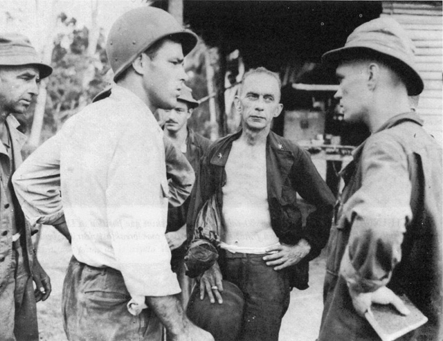 General Albert W. Waldron (center, facing forward) commanding general, 32nd Division Artillery, discusses plans for the impending battle on 15 November 1942. He was appointed by Maj. Gen. Robert Eichelberger as commanding officer of the 32nd Infantry Division on 3 December 1942, but was wounded by a Japanese sniper on 5 December 1942.